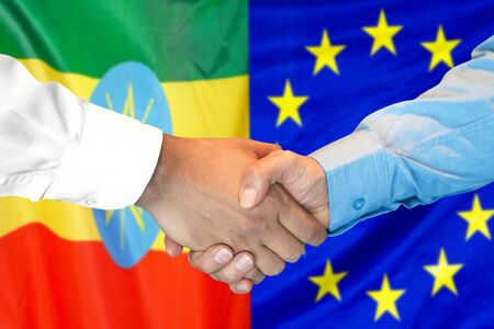 Business handshake on the background of two flags. Men handshake on the background of the Ethiopia and European Union flag. Support concept Zdjęcie Seryjne