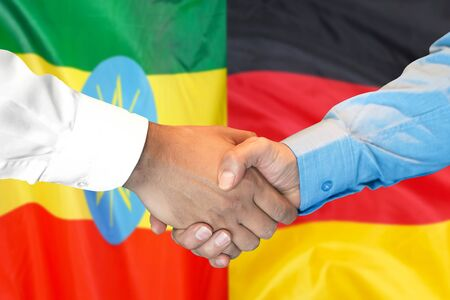 Business handshake on the background of two flags. Men handshake on the background of the Ethiopia and Germany flag. Support concept Zdjęcie Seryjne