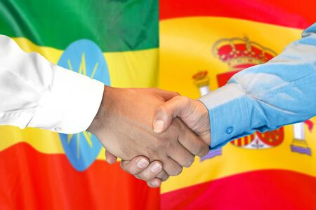 Business handshake on the background of two flags. Men handshake on the background of the Ethiopia and Spain flag. Support concept