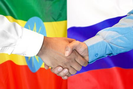 Business handshake on the background of two flags. Men handshake on the background of the Ethiopia and Russia flag. Support concept