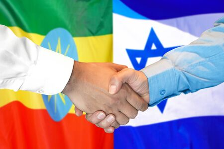 Business handshake on the background of two flags. Men handshake on the background of the Ethiopia and Israel flag. Support concept