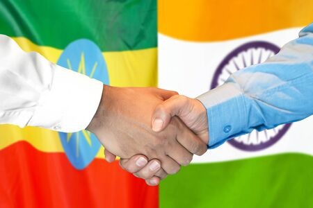 Business handshake on the background of two flags. Men handshake on the background of the Ethiopia and India flag. Support concept
