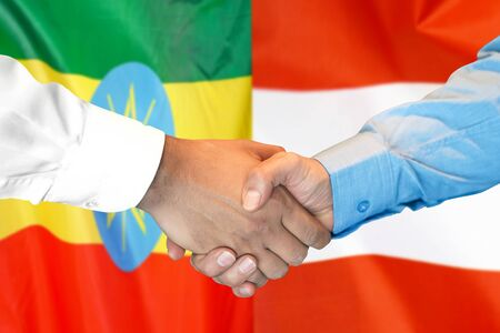 Business handshake on the background of two flags. Men handshake on the background of the Ethiopia and Austria flag. Support concept Zdjęcie Seryjne