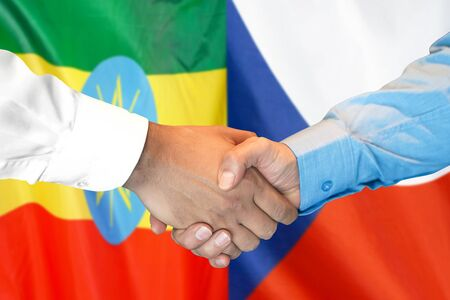 Business handshake on the background of two flags. Men handshake on the background of the Ethiopia and Czech Republic flag. Support concept