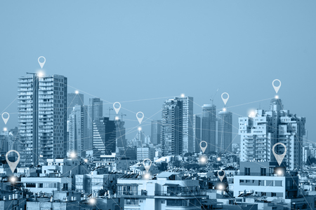 Location gps or Map pin flat above blue tone city Tel Aviv scape and network connection concept. Blue tone city scape and network connection concept.