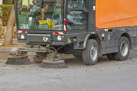 Street sweeper machine working. Street cleaning machine. Publikacyjne