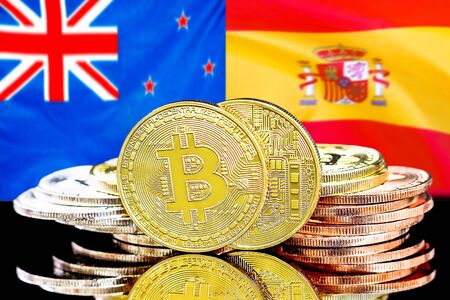 Concept for investors in cryptocurrency and Blockchain technology in the New Zealand and Spain. Bitcoins on the background of the flag New Zealand and Spain.