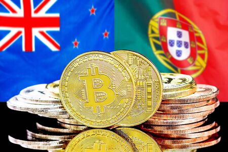Concept for investors in cryptocurrency and Blockchain technology in the New Zealand and Portugal. Bitcoins on the background of the flag New Zealand and Portugal.