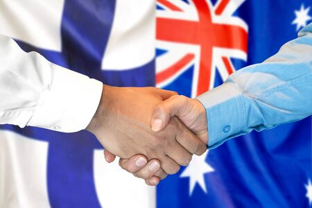 Business handshake on the background of two flags. Men handshake on the background of the Finland and Australia flag. Support concept Stock fotó