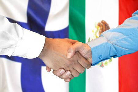 Business handshake on the background of two flags. Men handshake on the background of the Finland and Mexico flag. Support concept Stock fotó