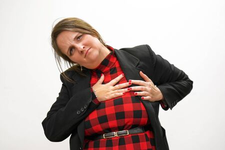 Woman suffering from chest pain heart attack isolated in white background. Healthcare and medical concept. Portrait of a young woman with chest pain touching chest