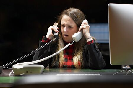 Portrait of office woman in stress. A lot of phone calls in office. An office worker female shouting in the phones. Funny face expression, emotions. Feelings problem reaction. Travel Agency Secretary.                                      Zdjęcie Seryjne