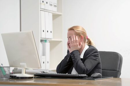 Office worker Woman suffering from headache migraine pain. Health problem, stress and depression. Female holds head with hand. Concept of health. Reklamní fotografie