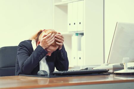 Office manager Woman suffering from headache migraine pain. Health problem, stress and depression. Female holds head with hand. Concept of health.