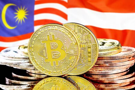 Concept for investors in cryptocurrency and Blockchain technology in the Malaysia and Austria. Bitcoins on the background of the flag Malaysia and Austria.