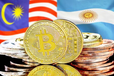 Concept for investors in cryptocurrency and Blockchain technology in the Malaysia and Argentina. Bitcoins on the background of the flag Malaysia and Argentina. Фото со стока