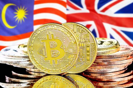 Concept for investors in cryptocurrency and Blockchain technology in the Malaysia and United Kingdom. Bitcoins on the background of the flag Malaysia and United Kingdom.
