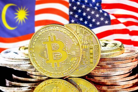 Concept for investors in cryptocurrency and Blockchain technology in the Malaysia and United States of America. Bitcoins on the background of the flag Malaysia and US. Фото со стока