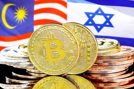 Concept for investors in cryptocurrency and Blockchain technology in the Malaysia and Israel. Bitcoins on the background of the flag Malaysia and Israel.