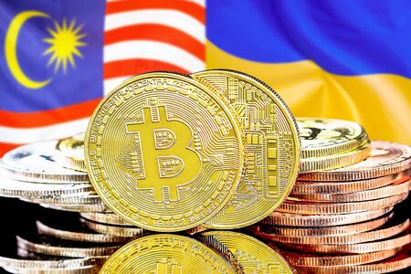 Concept for investors in cryptocurrency and Blockchain technology in the Malaysia and Ukraine. Bitcoins on the background of the flag Malaysia and Ukraine. Фото со стока