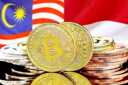 Concept for investors in cryptocurrency and Blockchain technology in the Malaysia and Monaco. Bitcoins on the background of the flag Malaysia and Monaco.