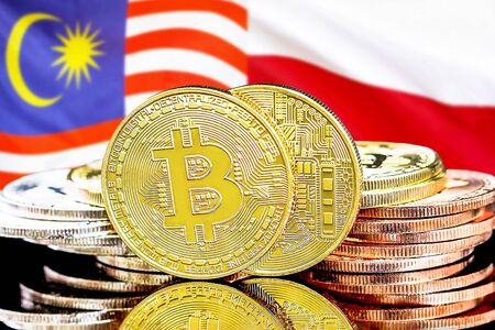 Concept for investors in cryptocurrency and Blockchain technology in the Malaysia and Poland. Bitcoins on the background of the flag Malaysia and Poland.