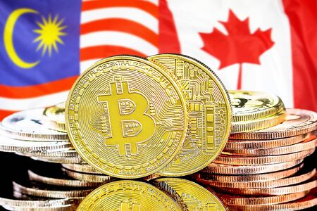Concept for investors in cryptocurrency and Blockchain technology in the Malaysia and Canada. Bitcoins on the background of the flag Malaysia and Canada.