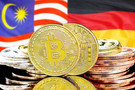Concept for investors in cryptocurrency and Blockchain technology in the Malaysia and Germany. Bitcoins on the background of the flag Malaysia and Germany.