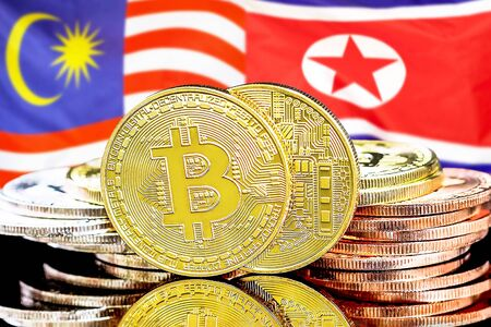 Concept for investors in cryptocurrency and Blockchain technology in the Malaysia and North Korea. Bitcoins on the background of the flag Malaysia and North Korea. Фото со стока