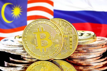 Concept for investors in cryptocurrency and Blockchain technology in the Malaysia and Russia. Bitcoins on the background of the flag Malaysia and Russia. Фото со стока