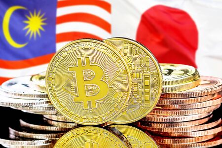 Concept for investors in cryptocurrency and Blockchain technology in the Malaysia and Japan. Bitcoins on the background of the flag Malaysia and Japan.