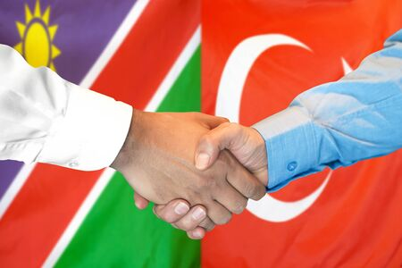 Business handshake on the background of two flags. Men handshake on the background of the Namibia and Turkey flag. Support concept