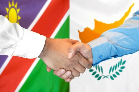 Business handshake on the background of two flags. Men handshake on the background of the Namibia and Cyprus flag. Support concept