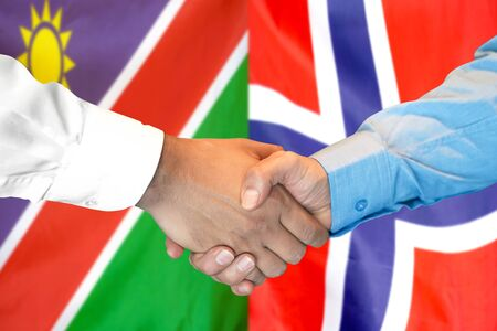 Business handshake on the background of two flags. Men handshake on the background of the Namibia and Norway flag. Support concept Zdjęcie Seryjne