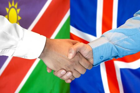 Business handshake on the background of two flags. Men handshake on the background of the Namibia and Iceland flag. Support concept