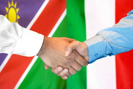 Business handshake on the background of two flags. Men handshake on the background of the Namibia and Italy flag. Support concept