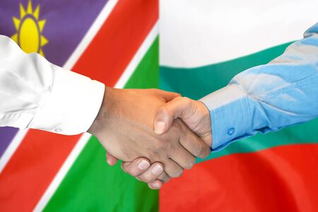 Business handshake on the background of two flags. Men handshake on the background of the Namibia and Bulgaria flag. Support concept Stock fotó