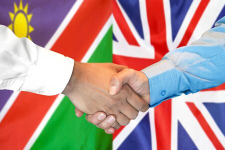 Business handshake on the background of two flags. Men handshake on the background of the Namibia and United Kingdom flag. Support concept