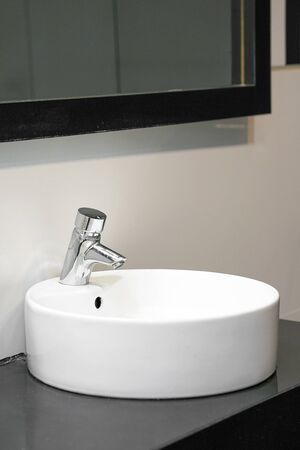 Bathroom interior sink with modern design. Interior of bathroom with washbasin and faucet.                               Stockfoto