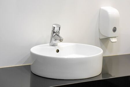 Bathroom interior sink with modern design. Interior of bathroom with washbasin and faucet.