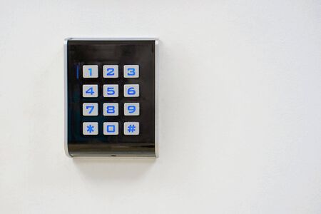 Secure password on keyboard for opening home house door. Password code Security keypad system protected in Public Building. The security code combination to unlock the door.