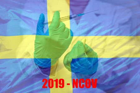 Hand of doctor or nurse in blue gloves holding syringe for vaccination against the background of the Sweden flag. Medicine concept and fight the virus.