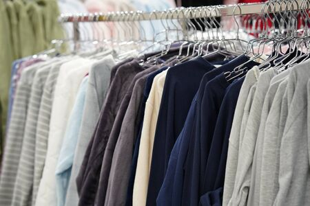 Fashionable clothing on hangers in shop. sport of T Shirts are hanging on Clothes Hanger, T Shirt. Clothes hanger with t shirt.
