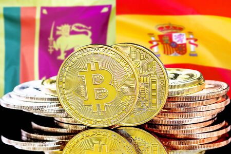 Concept for investors in cryptocurrency and Blockchain technology in the Sri Lanka and Spain. Bitcoins on the background of the flag Sri Lanka and Spain.