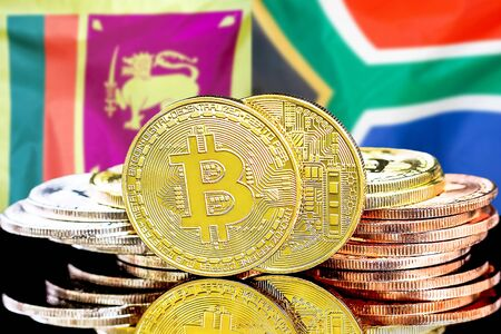 Concept for investors in cryptocurrency and Blockchain technology in the Sri Lanka and South Africa. Bitcoins on the background of the flag Sri Lanka and South Africa.