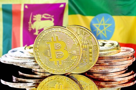 Concept for investors in cryptocurrency and Blockchain technology in the Sri Lanka and Ethiopia. Bitcoins on the background of the flag Sri Lanka and Ethiopia. Stock Photo