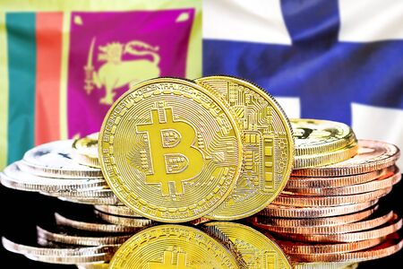Concept for investors in cryptocurrency and Blockchain technology in the Sri Lanka and Finland. Bitcoins on the background of the flag Sri Lanka and Finland. Stock Photo