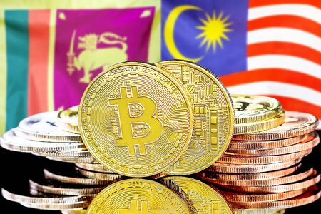 Concept for investors in cryptocurrency and Blockchain technology in the Sri Lanka and Malaysia. Bitcoins on the background of the flag Sri Lanka and Malaysia.
