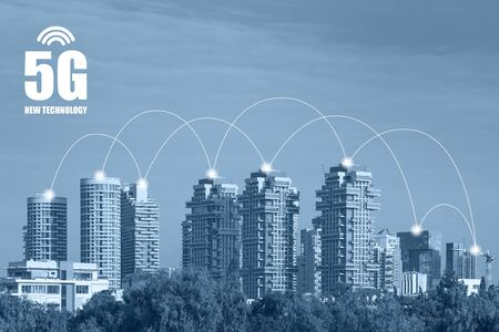 Internet of things. Smart grid. Conceptual abstraction. 5G technology. Modern city and communication network, Smart City. Green tone city scape and network connection concept. Stock Photo