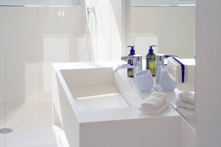 Interior of bathroom with washbasin and faucet. Bathroom interior sink with modern design in luxury hotel. Archivio Fotografico